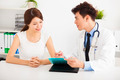 asian doctor talking with female patient in  office - PhotoDune Item for Sale