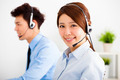 businesswoman and businessman with headset working in office - PhotoDune Item for Sale