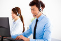 smiling business man and woman with headset working in office - PhotoDune Item for Sale