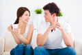 happy Young couple relaxing in sofa - PhotoDune Item for Sale