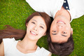 Top view of young couple  lying together on the grass - PhotoDune Item for Sale