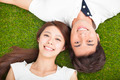 Top view of young couple in love lying together on the grass - PhotoDune Item for Sale