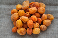 Heap of dried apricots on hessian linen fabric cloth - PhotoDune Item for Sale