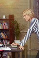 Woman Leaning on the Table with Laptop Computer - PhotoDune Item for Sale