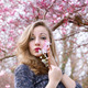 Portrait of a young woman with spring flowers - PhotoDune Item for Sale