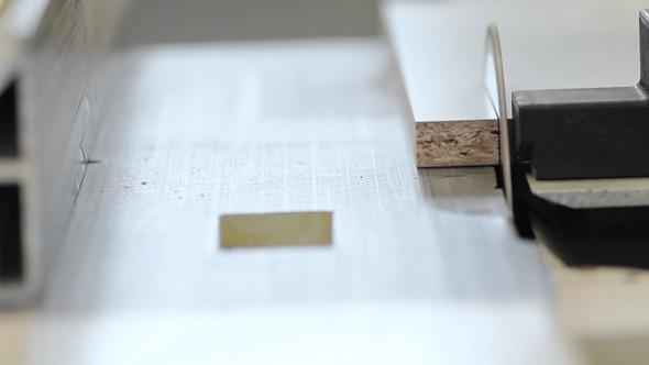 Carpenter Sawing the Wooden Desk