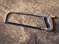 old hacksaw on concrete grungy background - PhotoDune Item for Sale
