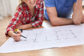 close up of couple with  blueprint at home - PhotoDune Item for Sale