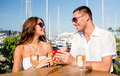 smiling couple with champagne and gift at cafe - PhotoDune Item for Sale