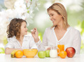 happy mother and daughter eating breakfast - PhotoDune Item for Sale