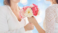 close up of happy lesbian couple with flowers - PhotoDune Item for Sale