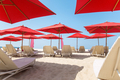 Beach chairs and umbrellas on a sand beach - PhotoDune Item for Sale