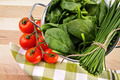 Fresh spinach leaves with tomatoes and strainer - PhotoDune Item for Sale