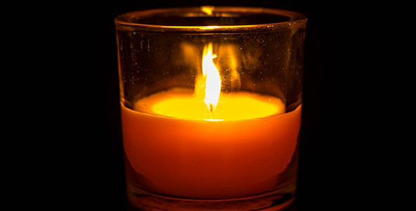 Candle In A Glass Burning