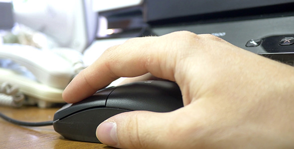Office Worker Using Computer Mouse