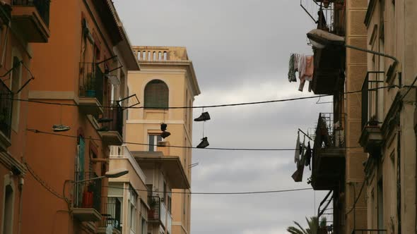 VideoHive Shoes Hanging From Washing Line In Barcelona 10971125