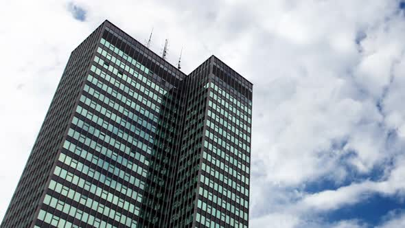 VideoHive Reflections Of Clouds Moving In Glass Mirrored Office Tower 10971180