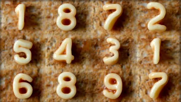 VideoHive Number Sequence Made From Spaghetti Pasta Letters In Tomato Sauce On Toast 5 10971214