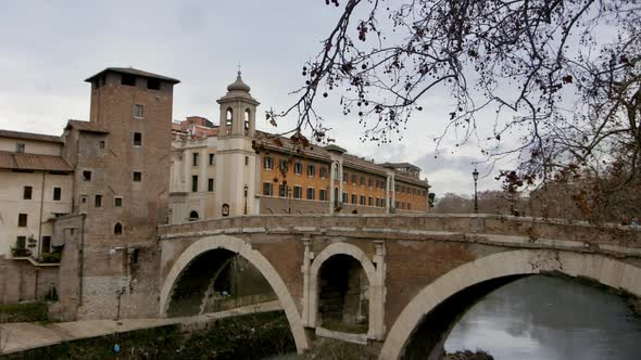 Bridge Over The River Into An Old Part Of Rome Italy