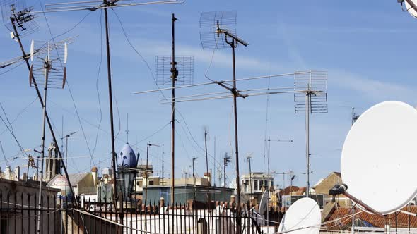 Abstract Pattern Of Tv Aerials And Satellites On Rooftops 1