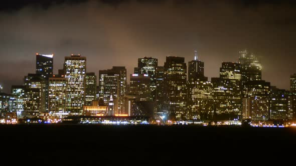 The Foggy San Francisco Skyline At Night 10