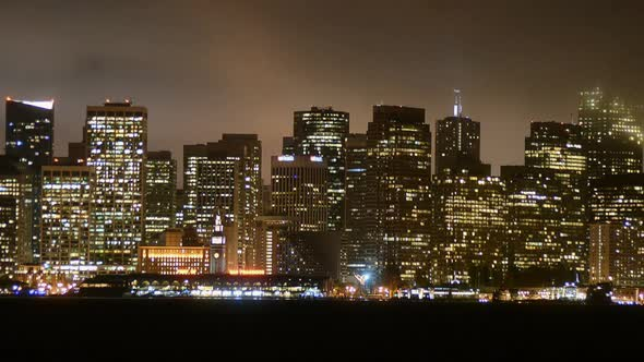 The Foggy San Francisco Skyline At Night 11