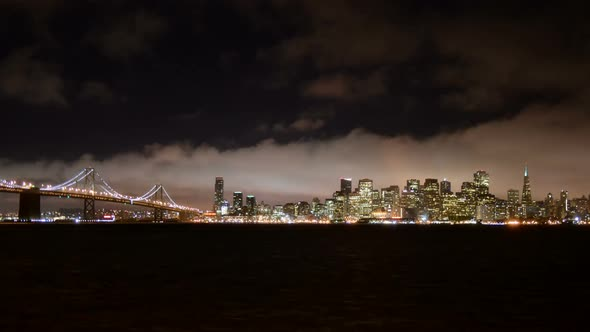 The Foggy San Francisco Skyline At Night 13