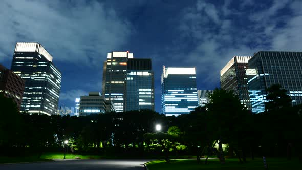 Clouds Passing Downtown Tokyo Skyline At Night From The Royal Garden