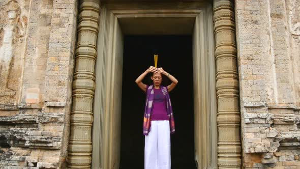 Female Buddhist Praying With Incense In Temple Doorway Angkor Wat Temple Cambodia 3