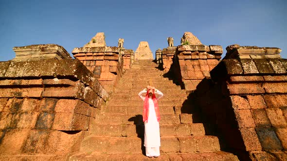 Female Buddhist Slowly Walking Down Temple Steps With Incense Angkor Wat Temple Cambodia 4