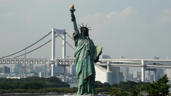 Replica Statue Of Liberty With Peace Bridge In The Background Tokyo Japan 4