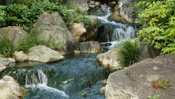 Waterfall Runs Into A Koi Pond At Sensoji Temple Tokyo Japan 2
