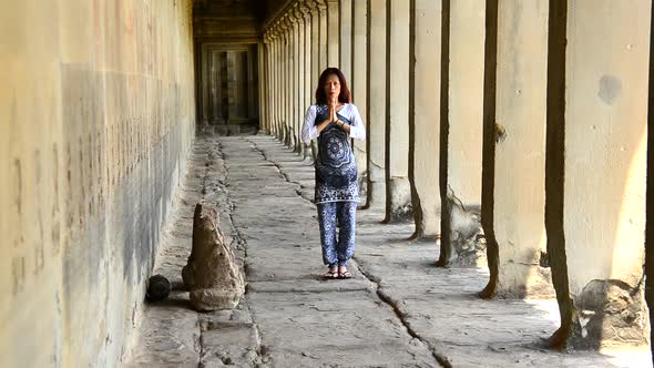 Female Buddhist With Hands In Prayer In Temple Hallway Angkor Wat Temple Cambodia