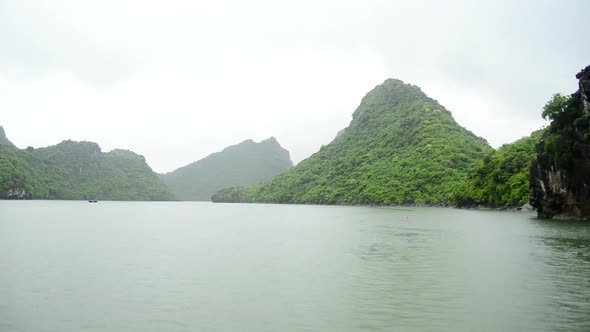 VideoHive Time Lapse Of Boats Pov On A Rainy Foggy Day In Ha Long Bay Vietnam 6 10976993