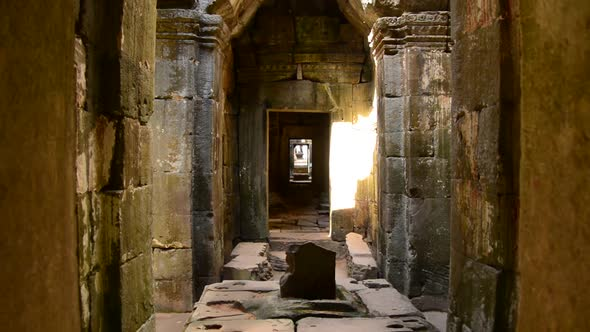 VideoHive Zoom Out Of Temple Hallway With Sunlight Shining In Angkor Wat Temple Cambodia 10977376