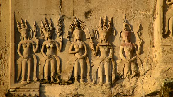 Stone Carving Of Religious Icons On Temple Wall Angkor Wat Cambodia 3