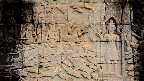 Stone carving of religious icons on temple wall angkor