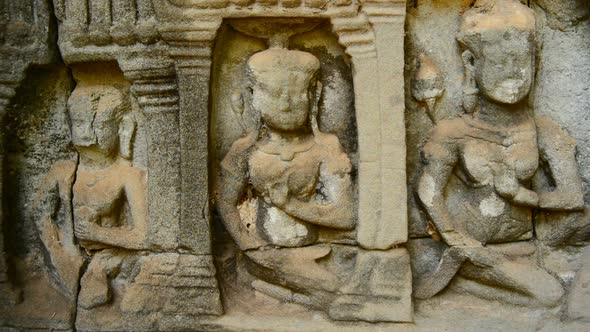 Stone Carving Of Religious Icons On Temple Wall Angkor Wat Cambodia 9