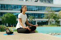 Business Woman Doing Yoga Lotus Position Outside Office Building - PhotoDune Item for Sale