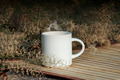 Coffee cup with small flower grass - PhotoDune Item for Sale