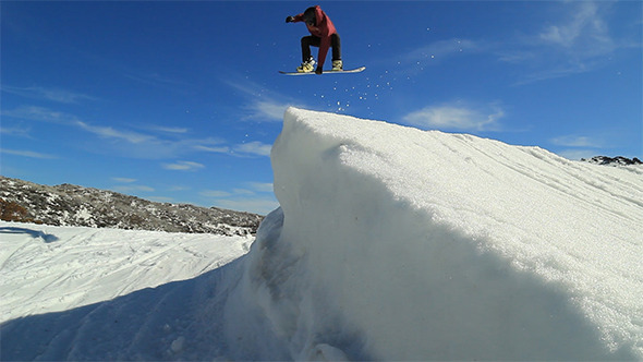 Skier and Snowboarder Jumping