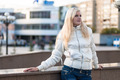 Blond woman over urban background - PhotoDune Item for Sale