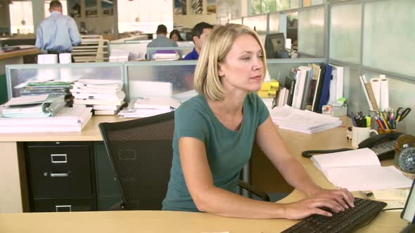 Woman Working At Computer In Modern Office 4