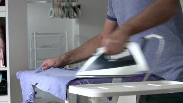 Man Ironing Laundry 3