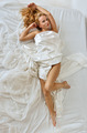 Beautiful naked woman on white bed. - PhotoDune Item for Sale