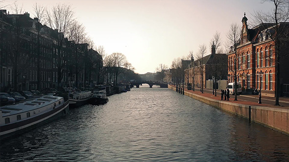 Sunset Light On Buildings By Canal