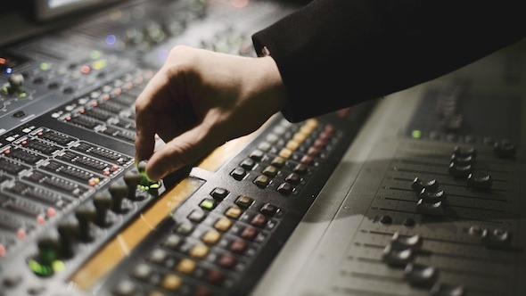 Working on audio mixer