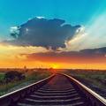 railway to horizon in sunset with low clouds