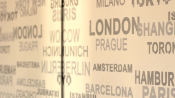 The Names Of Major Cities Sweep In Front Of Camera