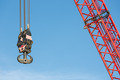 Red crane boom with hook against blu sky - PhotoDune Item for Sale